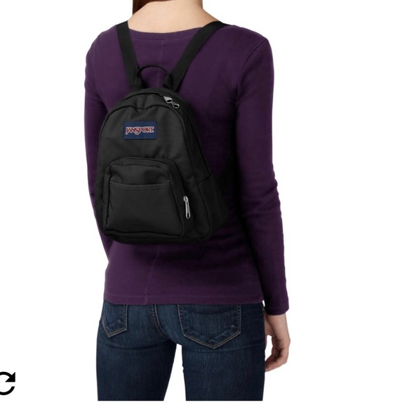 cf608d4f793 Black jansport half pint mini backpack purse bag. M_5b0cb0dd9cc7efac6cff9c29